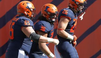 Illinois's Mike Epstein, right, celebrates his touchdown against South Florida with teammates Doug Kramer, left, and Austin Roberts during the first half of an NCAA college football game Saturday, Sept. 15, 2018, in Chicago. (AP Photo/Jim Young)