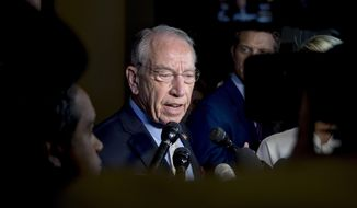 Senate Judiciary Committee Chairman Chuck Grassley, R-Iowa, speaks to reporters on Capitol Hill, Wednesday, Sept. 19, 2018, in Washington. Christine Blasey Ford wants the FBI to investigate her allegation that she was sexually assaulted by Supreme Court nominee Brett Kavanaugh before she testifies at a Senate Judiciary Committee hearing next week. (AP Photo/Andrew Harnik) **FILE**