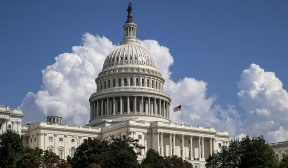 In this Monday, Sept. 3, 2018, file photo, an American flag flies on the U.S. Capitol in Washington. (AP Photo/J. Scott Applewhite, File)