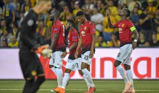Manchester United's Paul Pogba, right, celebrates after scoring  during the Champions League group H soccer match between Young Boys and Manchester United at the Stade de Suisse in Berne, Switzerland, Wednesday, Sept. 19, 2018. (Anthony Anex/Keystone via AP)