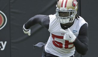 FILE - In this May 30, 2018, file photo, San Francisco 49ers linebacker Reuben Foster runs during a practice at the team's NFL football training facility in Santa Clara, Calif. San Francisco figures to get a big boost on defense from Foster, who returns this week after he was suspended for the first two games of the season for violating the league's substance abuse and personal conduct policy. (AP Photo/Jeff Chiu, File)
