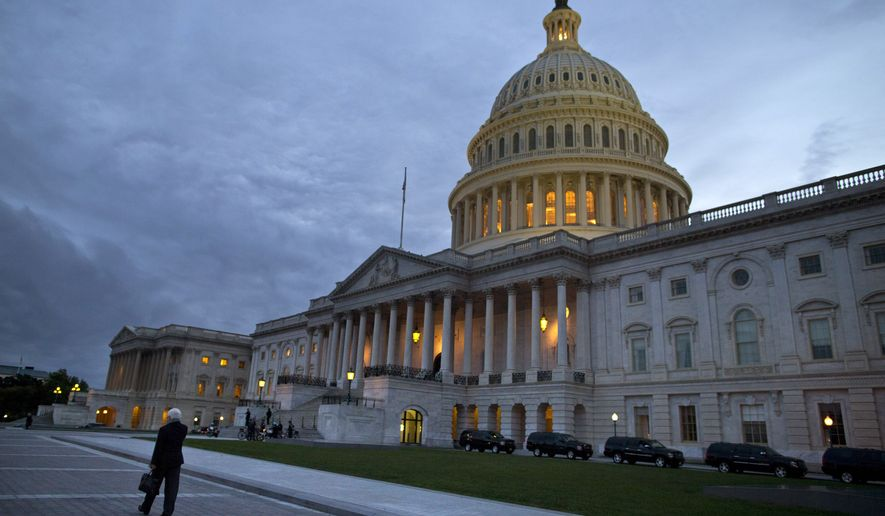 This Oct. 15, 2013, photo, shows a view of the U.S. Capitol building at dusk in Washington. Even if Congress reaches a last-minute or deadline-busting deal to avert a federal default and fully reopen the government, elected officials are likely to return to their grinding brand of brinkmanship, perhaps repeatedly. House-Senate talks are barely touching the underlying causes of debt-and-spending stalemates that pushed the country close to economic crises in 2011, last December and again this month.  (AP Photo/ Evan Vucci)