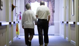In this Nov. 6, 2015, photo, an elderly couple walks down a hall in Easton, Pa. It's not too late to get moving: Simple physical activity, mostly walking, helped high-risk seniors stay mobile after disability-inducing ailments even if, at 70 and beyond, they'd long been couch potatoes. (AP Photo/Matt Rourke) **FILE**