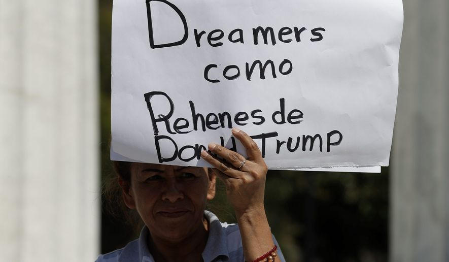 "A woman holds up signs reading in Spanish: ""Dreamers as prisoners of Donald Trump,"" and ""Stop deportations that separate families, causing pain, anguish, and tears"", as a handful of demonstrators protested outside the Ministry of Foreign Relations, where U.S. Secretary of State Rex Tillerson was meeting with his Mexican and Canadian counterparts in Mexico City, Friday, Feb. 2, 2018. Tillerson's Mexico stop kicks off a weeklong trip to Latin America which will take him to Argentina, Peru, and Colombia, with a final stop in Jamaica. (AP Photo/Rebecca Blackwell)"