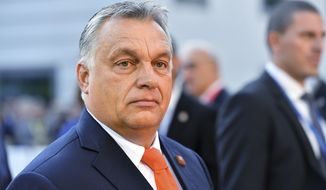 Hungarian Prime Minister Viktor Orban arrives at the informal EU summit in Salzburg, Austria, Thursday, Sept. 20, 2018. (AP Photo/Kerstin Joensson)