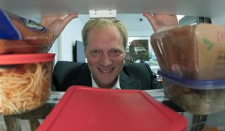 In this Dec. 6, 2016, photo, Brian Wansink poses for a photo in a food lab at Cornell University in Ithaca, N.Y. On Thursday, Sept. 20, 2018, Cornell said the prominent professor of food research has resigned after an investigation found he committed academic misconduct. (Associated Press) **FILE**