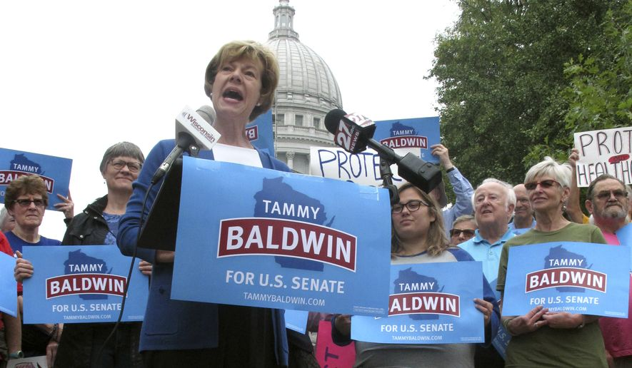 U.S. Sen. Tammy Baldwin, D-Wis. speaks to supporters and talks about her support for the national health care law before encouraging early voting on Thursday, Sept. 20, 2018, in Madison, Wis. Baldwin faces Republican Leah Vukmir in the November election. (AP Photo/Scott Bauer)