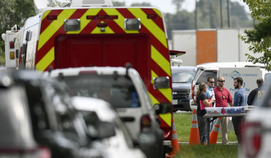 Law enforcement officials gather near the scene where a shooting took place in Aberdeen, Md., on Thursday, Sept. 20, 2018. (AP Photo/Steve Ruark)