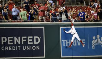 Washington Nationals center fielder Victor Robles (16) leaps in vain for a home run by New York Mets' Jay Bruce during the third inning of a baseball game Thursday, Sept. 20, 2018, in Washington. (AP Photo/Nick Wass)