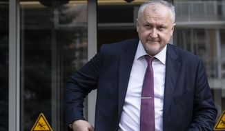 Russian National Anti-doping Agency RUSADA head Yuri Ganus leaves the office in Moscow, Russia, Thursday, Sept. 20, 2018. The World Anti-Doping Agency has reinstated Russia, ending a nearly three-year suspension caused by state-sponsored doping. (AP Photo/Alexander Zemlianichenko)