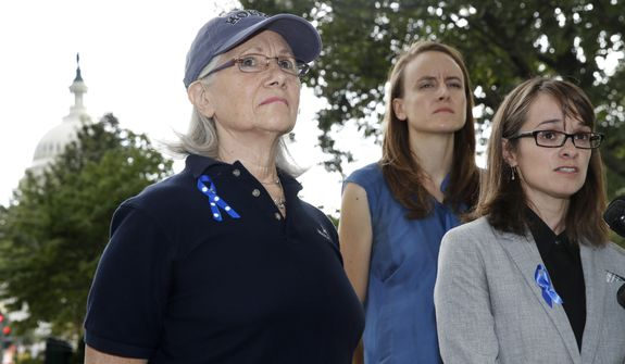 Alumni of Holton-Arms School, Karen Bralove, class of 1963, left, Sarah Burgess, class of 2005, and Alexis Goldstein, class of 1999, speak to members of the media about a letter they delivered to the office of Sen. Shelley Moore Capito, R-W.Va., who is also an alumni of the school, Thursday, Sept. 20, 2018, on Capitol Hill in Washington. The letter, which the group wants Capito to sign, calls for an independent investigation of accusations by Christine Blasey Ford, a 1984 alumni of the school, against Supreme Court nominee Brett Kavanaugh. (AP Photo/Jacquelyn Martin)