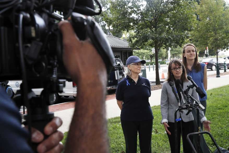 Alumni of Holton-Arms School, Karen Bralove, class of 1963, left, Alexis Goldstein, class of 1999, and Sarah Burgess, class of 2005, speak to members of the media about a letter they delivered to the office of Sen. Shelley Moore Capito, R-W.Va., who is also an alumni of the school, Thursday, Sept. 20, 2018, on Capitol Hill in Washington. The letter, which the group wants Capito to sign, calls for an independent investigation of accusations by Christine Blasey Ford, a 1984 alumni of the school, against Supreme Court nominee Brett Kavanaugh. (AP Photo/Jacquelyn Martin)