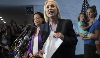 Sen. Kirsten Gillibrand, D-N.Y., with Sen. Mazie Hirono, D-Hawaii, left, joined by former students from Holton Arms School, speaks to reporters in support of professor Christine Blasey Ford, who is accusing Supreme Court nominee Brett Kavanaugh of a decades-old sexual attack, during a news conference on Capitol Hill in Washington, Thursday, Sept. 20, 2018. (AP Photo/J. Scott Applewhite)