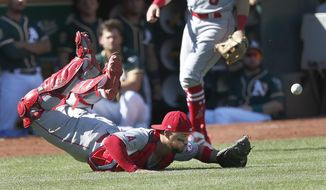 Los Angeles Angels catcher Francisco Arcia can't make the catch on a foul ball against the Oakland Athletics during the sixth inning in a baseball game in Oakland, Calif., Thursday, Sept. 20, 2018. (AP Photo/Tony Avelar)