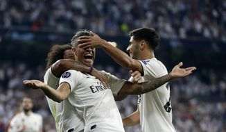Real forward Mariano Diaz, center, celebrates with teammates after scoring his side's third goal during a Group G Champions League soccer match between Real Madrid and Roma at the Santiago Bernabeu stadium in Madrid, Spain, Wednesday Sept. 19, 2018. (AP Photo/Manu Fernandez)
