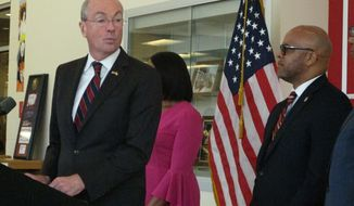 New Jersey Gov. Phil Murphy, left, announces his administration will leave a state takeover in place in Atlantic City N.J. during a speech in the city on Sept. 20, 2018, as Mayor Frank Gilliam, right, looks on. (AP Photo/Wayne Parry)