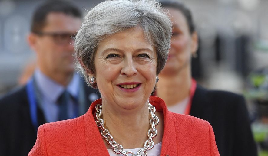British Prime Minister Theresa May smiles when arriving at the informal EU summit in Salzburg, Austria, Thursday, Sept. 20, 2018. (AP Photo/Kerstin Joensson)
