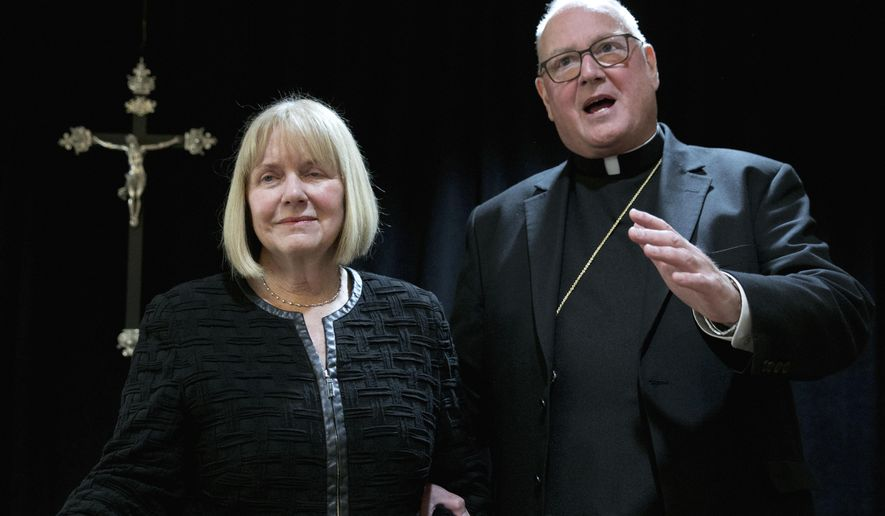 Cardinal Timothy Dolan addresses a news conference at the offices of the New York Archdiocese, in New York, Thursday, Sept. 20, 2018. The Roman Catholic Archdiocese of New York said Thursday that it has hired former federal judge Barbara Jones, left, to review its procedures and protocols for handling allegations of sexual abuse. (AP Photo/Richard Drew)