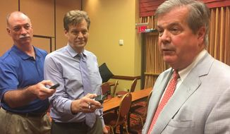 Democratic gubernatorial candidate Karl Dean, right, talks to reporters, Thursday, Sept. 20, 2018, in Nashville, Tenn. Dean and GOP opponent Bill Lee were scheduled to speak at a forum, but Lee canceled at the last minute. (AP Photo/Kimberlee Kruesi)