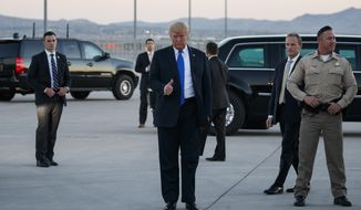 President Donald Trump gives a thumbs-up as he arrives at McCarran International Airport for a campaign rally, Thursday, Sept. 20, 2018, in Las Vegas. (AP Photo/Evan Vucci)