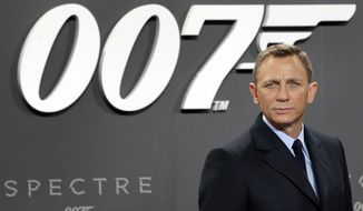 """In this Oct. 28, 2015, file photo, actor Daniel Craig poses for the media as he arrives for the German premiere of the James Bond movie """"Spectre"""" in Berlin, Germany. (AP Photo/Michael Sohn, File)"""