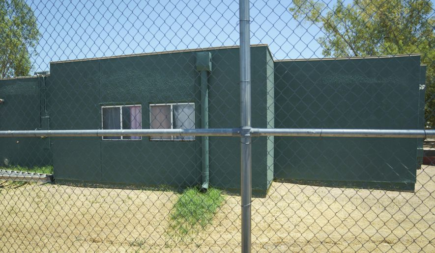 FILE - In this June 28, 2018, file photo, buildings that house juveniles and operations on the grounds of Southwest Key Campbell, a shelter for children that have been separated form their parents in Phoenix, Ariz. are seen. Arizona officials have moved to revoke the licenses for the nonprofit that houses immigrant children after it missed a deadline to show that all its employees passed background checks. (AP Photo/Carolyn Kaster, file)