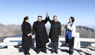 South Korean President Moon Jae-in, second from right, and his wife Kim Jung-sook, right, stand with North Korean leader Kim Jong-un, second from left, and his wife Ri Sol-ju on the Mount Paektu in North Korea, Thursday, Sept. 20, 2018. (Pyongyang Press Corps Pool via AP)