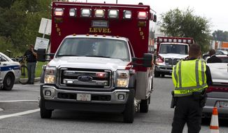 "Ambulance leave the industrial park where several people had been shot, according with police reports in Aberdeen, Md, in Thursday, Sept. 20, 2018. Authorities say multiple people have been shot in northeast Maryland in what the FBI is describing as an ""active shooter situation."" (AP Photo/Jose Luis Magana)"