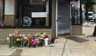 A makeshift memorial for Wendy Martinez grows outside a restaurant in Northwest D.C. Martinez was fatally stabbed in the Logan Circle neighborhood on Tuesday, Sept. 18, and Metropolitan Police announced the arrest of a suspect, Anthony Crawford, in a Sept. 20 news conference. (Jeff Mordock/The Washington Times)