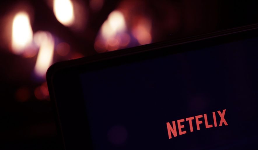 FILE- This Jan. 17, 2017, file photo, shows Netflix on a tablet, in North Andover, Mass. S&P Dow Jones Indices is shuffling the line-up of three of the 11 groups that make up the benchmark S&P 500 index. On Monday, 20 companies in the index including famous names like Facebook, Alphabet and Netflix will find a new home. (AP Photo/Elise Amendola, File)