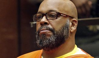 """In this July 7, 2015, file photo, Marion Hugh """"Suge"""" Knight sits for a hearing in his murder case in Superior Court in Los Angeles. Knight has pleaded no contest to voluntary manslaughter and after he ran over two men, killing one, nearly four years ago.The Death Row Records co-founder entered the plea Thursday in Los Angeles Superior Court and has agreed to serve 28 years in prison. (Patrick T. Fallon/Pool Photo via AP, File)"""