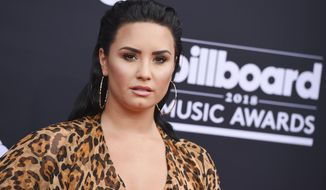 """FILE - In this May 20, 2018, file photo, Demi Lovato arrives at the Billboard Music Awards at the MGM Grand Garden Arena in Las Vegas. Lovato's mother said in an interview aired on Newsmax TV, the singer is """"doing really well"""" nearly two months after being hospitalized for a drug overdose. (Photo by Jordan Strauss/Invision/AP, File)"""