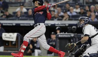 Boston Red Sox's Mookie Betts watches his three-run home run during the eighth inning of a baseball game against the New York Yankees on Thursday, Sept. 20, 2018, in New York. (AP Photo/Frank Franklin II)