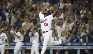 Los Angeles Dodgers' Yasiel Puig celebrates his three-run home run during the seventh inning against the Colorado Rockies in a baseball game Wednesday, Sept. 19, 2018, in Los Angeles. (AP Photo/Jae C. Hong)