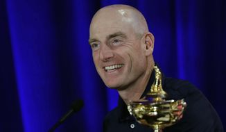 FILE - In this Sept. 4, 2018, file photo, Jim Furyk, U.S. Ryder Cup team captain, smiles during a news conference in West Conshohocken, Pa. The 42nd Ryder Cup Matches will be held in France from Sept. 28-30, 2018, at the Albatros Course of Le Golf National. (AP Photo/Matt Slocum, File)