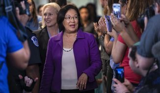 Sen. Mazie Hirono, D-Hawaii, with Sen. Kirsten Gillibrand, D-N.Y., left, is applauded by demonstrators as the arrive to speak to reporters in support of professor Christine Blasey Ford, who is accusing Supreme Court nominee Brett Kavanaugh of a decades-old sexual attack, during a news conference on Capitol Hill in Washington, Thursday, Sept. 20, 2018. (AP Photo/J. Scott Applewhite)