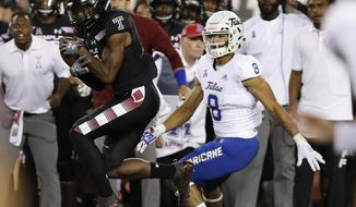 Temple cornerback Ty Mason intercepts the football in front of Tulsa wide receiver Keenen Johnson during the first half of an NCAA college football game, Thursday, Sept. 20, 2018 in Philadelphia. (Yong Kim/The Philadelphia Inquirer via AP)