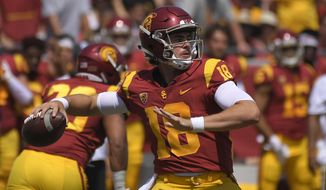 FILE - In this Sept. 1, 2018, file photo, Southern California quarterback J.T. Daniels passes during the first half of an NCAA college football game against UNLV in Los Angeles. The Trojans will attempt to avoid their first three-game losing streak in a single season since 2012 when they host unbeaten Washington State at the Coliseum in their first Friday night home game since 1999. (AP Photo/Mark J. Terrill, File)