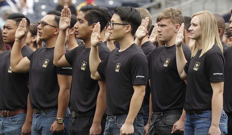 In this June 4, 2017, photo. new Army recruits take part in a swearing in ceremony before a baseball game between the San Diego Padres and the Colorado Rockies in San Diego. The Army has missed its recruiting goal for the first time in more than a decade. Army leaders tell The Associated Press they signed up about 70,000 new troops for the fiscal year that ends Sept. 30, 2018. (AP Photo/Gregory Bull) **FILE**