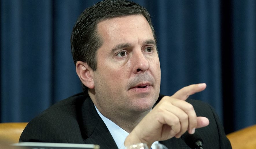 In this Wednesday, March 21, 2018, file photo, Rep. Devin Nunes, R-Calif,. is seen during the hearing on trade policy before the House Ways and Means Committee on Capitol Hill in Washington. (AP Photo/Jose Luis Magana, File) ** FILE **