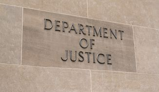 WASHINGTON, DC - JULY 12: United States Department of Justice sign in Washington, DC on July 12, 2017 Paul Brady Photography / Shutterstock.com