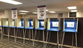 Voting booths stand ready in downtown Minneapolis on Thursday, Sept. 20, 2018, for Friday's opening of early voting in Minnesota. Minnesota and South Dakota are tied for the earliest start in the country for early voting in the 2018 midterm elections. (AP Photo/Steve Karnowski)
