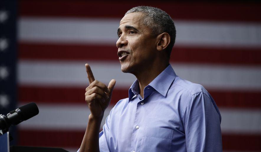 Former President Barack Obama speaks as he campaigns in support of Pennsylvania candidates in Philadelphia, Friday, Sept. 21, 2018. (AP Photo/Matt Rourke)