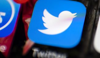 This April 26, 2017, file photo shows the Twitter app on a smartphone in Philadelphia. Twitter says it found a software bug that may have sent some private messages to the wrong people. But the company says the problem specifically involved direct messages or protected tweets sent to businesses and other accounts overseen by software developers. (AP Photo/Matt Rourke)
