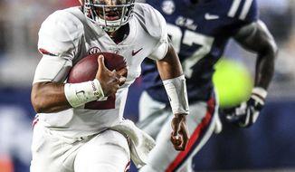 Alabama quarterback Jalen Hurts (2) runs as Mississippi defensive end Qaadir Sheppard (97) pursues during an NCAA college football game, Saturday, Sept. 15, 2018, in Oxford, Miss. Alabama won 62-7. (Bruce Newman/The Oxford Eagle via AP)