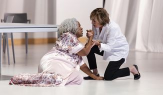 "This Sept. 18, 2018 photo released by Opera Philadelphia, Mezzo-soprano Marietta Simpson, left, and Frederica von Stade in the new opera ""Sky on Swings"" premiering as part of Opera Philadelphia's O18 Festival. (Dominic  M.  Mercier/Opera Philadelphia via AP)"