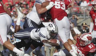 BYU's Squally Canada dives into the end zone for a touchdown during the second half of an NCAA college football game against Wisconsin Saturday, Sept. 15, 2018, in Madison, Wis. (AP Photo/Morry Gash)