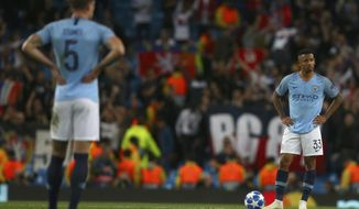 Manchester City's Gabriel Jesus, right, and Manchester City's John Stones, left, stand with their hands on their hips after Lyon score their second goal during the Champions League Group F soccer match between Manchester City and Lyon at the Etihad stadium in Manchester, England, Wednesday, Sept. 19, 2018. (AP Photo/Dave Thompson)