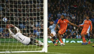 Manchester City's Sergio Aguero fails to score during the Champions League Group F soccer match between Manchester City and Lyon at the Etihad stadium in Manchester, England, Wednesday, Sept. 19, 2018. (AP Photo/Dave Thompson)