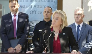 Sacramento County District Attorney Anne Marie Schubert, discusses the arrest of Roy Charles Waller, who is suspected of committing a series or rapes, during a news conference Friday, Sept. 21, 2018, in Sacramento, Calif. Waller, 58, was taken into custody in Berkeley by Sacramento Police, Wednesday Sept. 20, 2018, and faces multiple counts of rapes that occurred in Northern California starting in 1991. In the background are from left, is Brian Staebell, Sonoma County chief deputy district attorney, Sacramento Police Sgt. Vance Chandler and Jeff Reisig, Yolo County District Attorney, right, (AP Photo/Rich Pedroncelli)